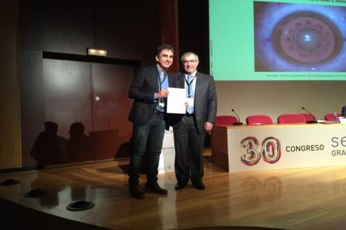 Jefe OFT recoge el premio de manos del presidente de SECOIR